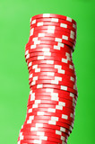 Stack of red casino chips against green background