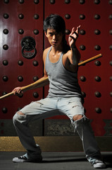 Young Asian Man Practising Martial Arts