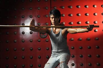 Young Asian Man Practising Martial Arts