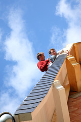 Two roofers.