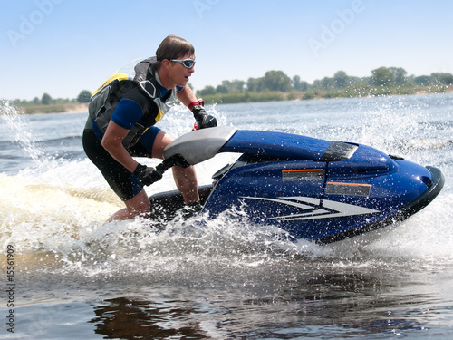 Fotobehang Water Motorsp. Man on jet ski rides very close