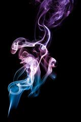 Coloured smoke isolated on black