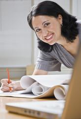Woman Working on Blueprints
