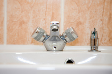 a closeup photo of the chrome tap