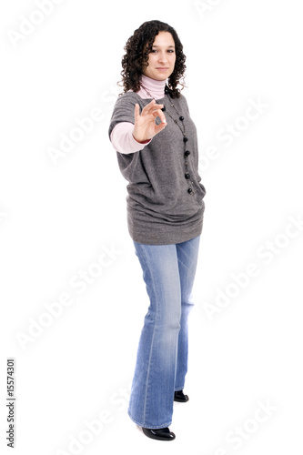 Young casual woman signaling Ok