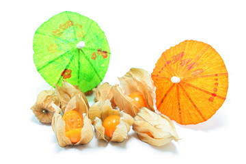 Physalis decorated with cocktail umbrellas, isolated on white