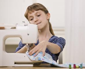 Girl on Sewing Machine