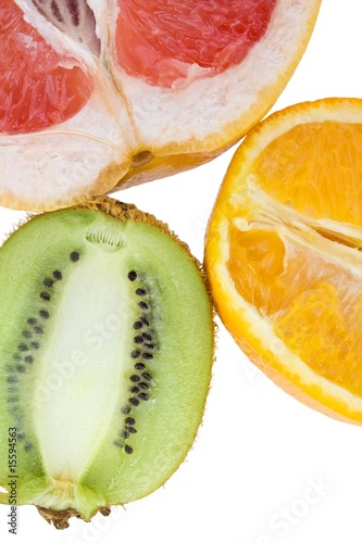 Fresh grapefruit, orange and kiwi isolated on white background