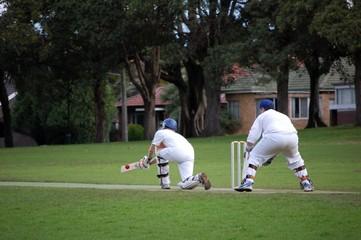 A batsman plays the sweep shot
