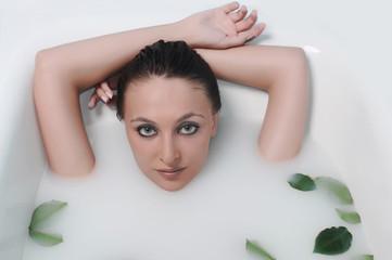 woman relaxing in a bathroom