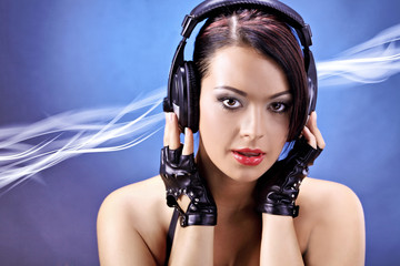 girl listening to music over a blue moving background