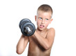 Young boy lifting a very heavy dumbbell