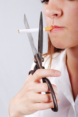 Young woman about to cut off her cigarete