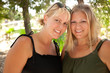 Two Beautiful Smiling Sisters Ourdoor Portrait