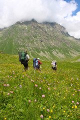 Hikers family  in Caucasus mountains