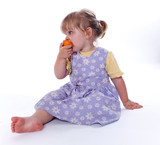 sitting on floor eating apricot young girl