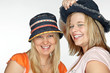 Two young ladies with hats