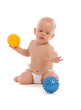 Portrait of little boy playing with two massage balls