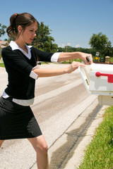 Professional Woman Checking the Mail in a Skirt