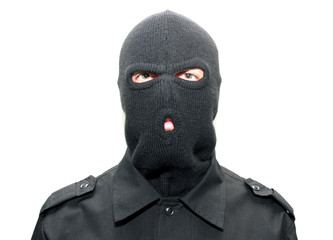 an burglar wearing a ski mask (balaclava) isolated on white