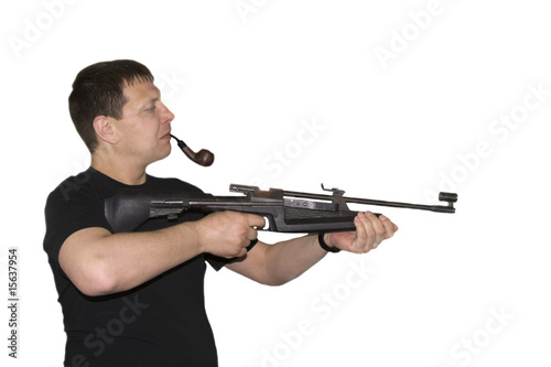 Man with carbine and pipe in mouth isolated over white