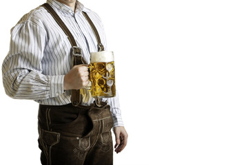 Bavarian man with leather trousers hold beer stein