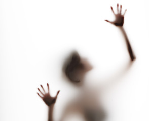upper torso of abstract, semi-obscured figure with arms raised