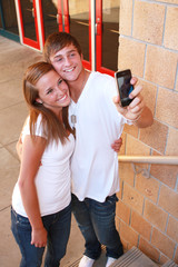 Teens with Camera Phone at School