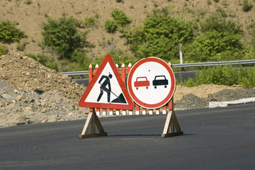 """Traffic signs """"Repair of the road"""" and """"Passing prohibited»"""
