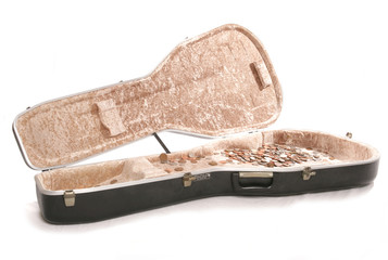 busking guitar case with british money