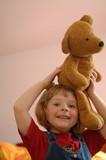 Girl with plush teddy bear poster