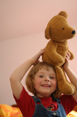 Girl with plush teddy bear