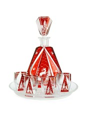 Red crystal carafe and liqueur-glasses on round plate isolated