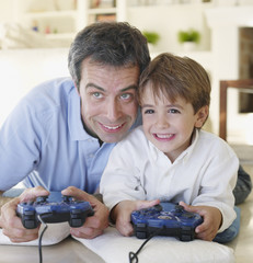 Man and boy playing video games