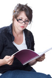 A young businesswoman in casual attire reviews her planner poster