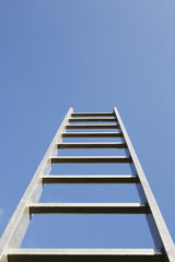 A ladder alone outdoors