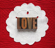 love on linen doily