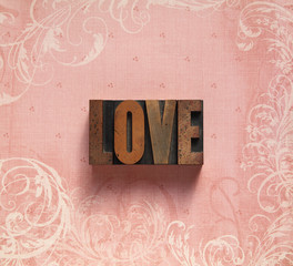 love word on a swirly background