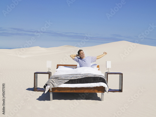 A man stretching in a bed outdoors