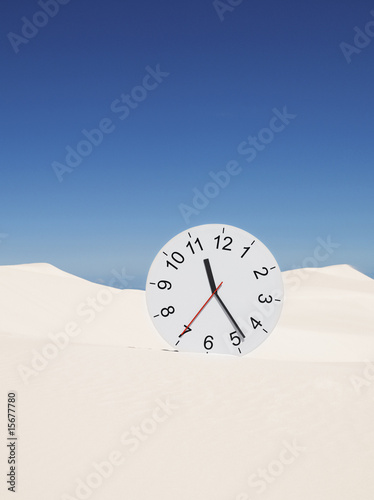 An oversized clock in the middle of a desert