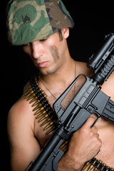 Military Man Holding Gun