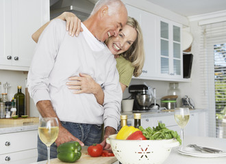A couple preparing food