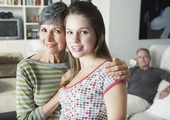 A grandparent and grandchild embracing