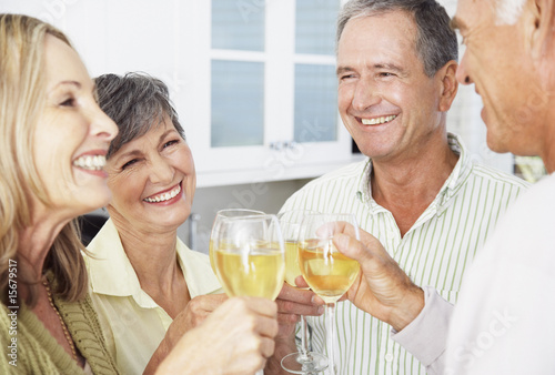 Two couples saluting their drinks