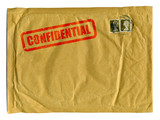 Large brown envelope with Confidential stamped on it in red ink poster