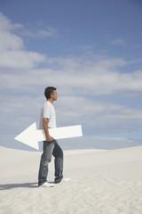 A man holding a directional arrow