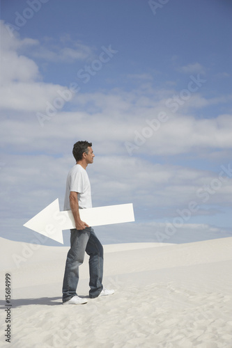 A man holding a directional arrow