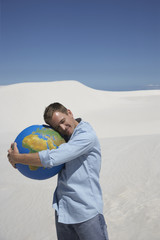 A man hugging a globe