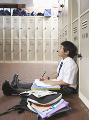 A student studying in the school hallway