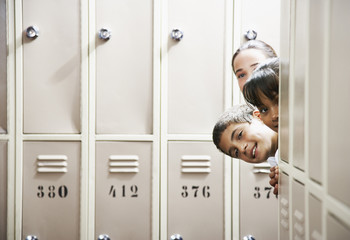 Students peeking around lockers